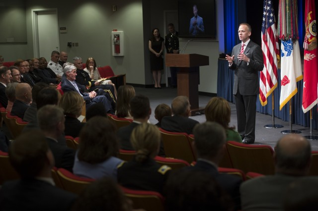 New Under Secretary of the Army Brad R. Carson gives remarks during his swearing-in ceremony at the Pentagon, May 9, 2014.