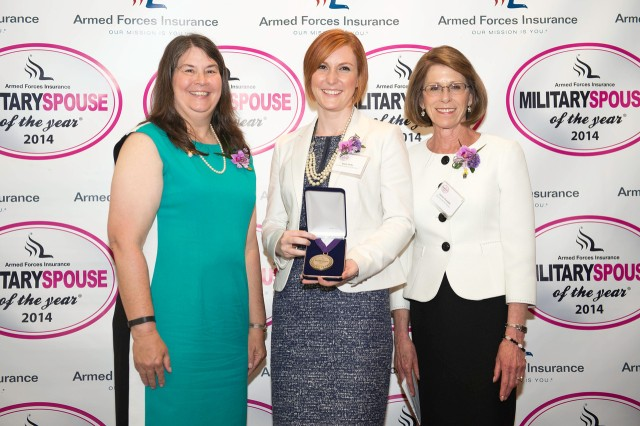 Reda Hicks (center) was selected as the Army Spouse of the Year for 2014. She was presented with a medallion by Ann Campbell (left), wife of Vice Chief of Staff of the Army Gen. John F. Campbell, and Jeanne Chandler, wife of Sgt. Maj. of the Army Raymond F. Chandler III.