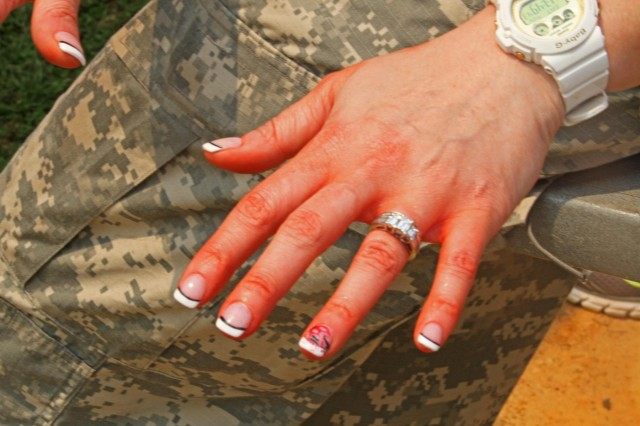 A spouse shows the aftermath of the medical lane, April 26, during the 3rd Squadron, 1st Cavalry Regiment, 3rd Armored Brigade Combat Team, 3rd Infantry Division, Spouses' Spur Ride.
