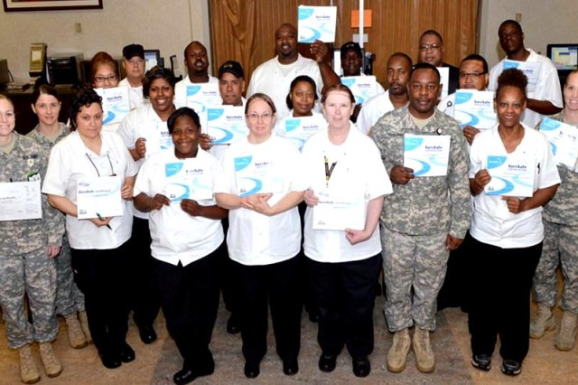 From left, 1st Lt. Kristina Fauser, Cpt. Donna Goodson, Theresa Favers, Maria Creel, William Jernigan, Monica Stoddard, Latonya Weaver, Isaiah Davis, Joseph Colon, Deborah Barrett, Kenyatta Brown, Erica Herrington, Debhra Laughlin, Leroy Johnson, Terence Williams, Master Sgt. Alvin Edwards, Gary A. Jakes, Charles Porter, Marian Bass, Rodney Gardner and Maj. Kimberly Brenda, Chief of the Nutrition Care Division. (DoD Photograph by Paul Clayton, DDEAMC Medical Photographer, U.S. Army/Released)