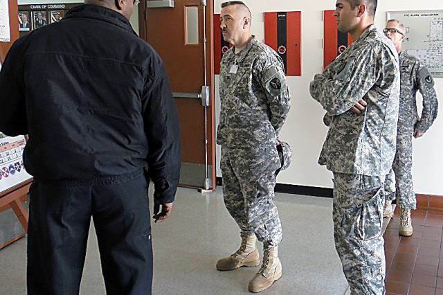 Col. Milford Nichols (second from left), Operations, Army Reserve Sustainment Command, receives a briefing  Feb. 26 from Lewis Nelson, Maintenance, Logistics Management System, followed by Capt. Gannon Hendrick (center), executive officer, 416th Army Field Support Brigade, and Lt. Col. Gary Cregan, commander, Army Field Support Battalion- Northeast Asia, during Key Resolve. (Courtesy photo)