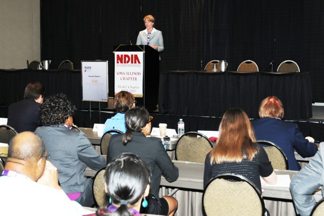 Patricia Huber, Joint Munitions Command deputy to the commander, provided small business owners insight to government contracting opportunities during the 2014 Midwest Small Business Symposium held, May 7-8 in Moline, IL.