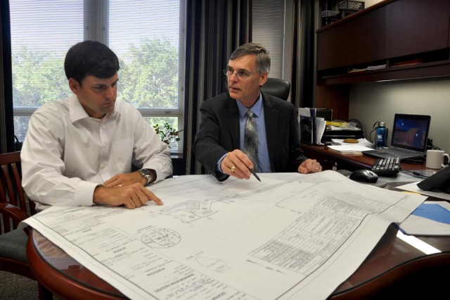 Real Property Exchange manager Stephen Bruce (left) and Real Estate Division Chief Ralph Werthmann review project drawings for Army Reserve property in Orland Park, Ill.