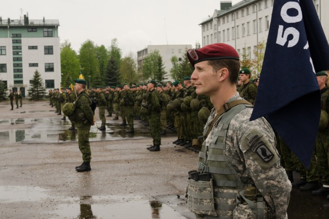 """Capt. Nicholas A. Salimbene, commander, Company B, 1st Battalion, 503rd Infantry Regiment, 173rd Airborne Brigade """"Sky Soldiers,"""" stands in front of American paratroopers as they join NATO allies from the Lithuanian army's """"Iron Wolf"""" Mechanized Infantry Brigade, at a ceremony to open Exercise Black Arrow 14 in Rukla, Lithuania, May 12, 2014. Black Arrow is a tactical field exercise that will train about 1,500 U.S. and Lithuanian troops, focusing on defensive operations and interoperability between the two forces and will include a combined airborne operation."""
