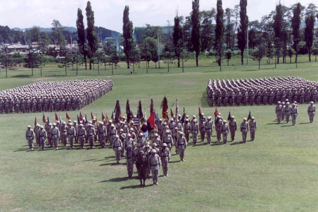The 2nd Brigade Combat Team stands in formation during their farewell ceremony, Aug. 1, 2004, at Camp Casey's Indianhead Field, in  South Korea, prior to its deployment to Iraq.