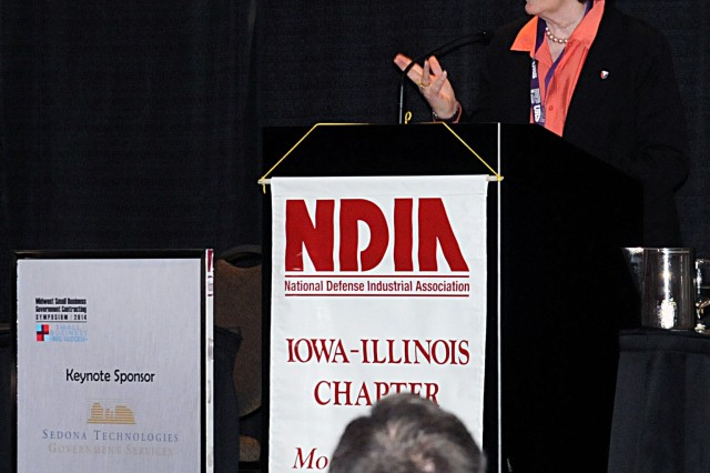 Kathryn Szymanski, U.S. Army Sustainment Command, speaks to a crowd of small business representatives during the 2014 Midwest Small Business and Government Contracting Symposium at the iWireless Center in Moline, 7 May. (Photo by Sgt. 1st Class Shannon Wright, ASC Public Affairs)