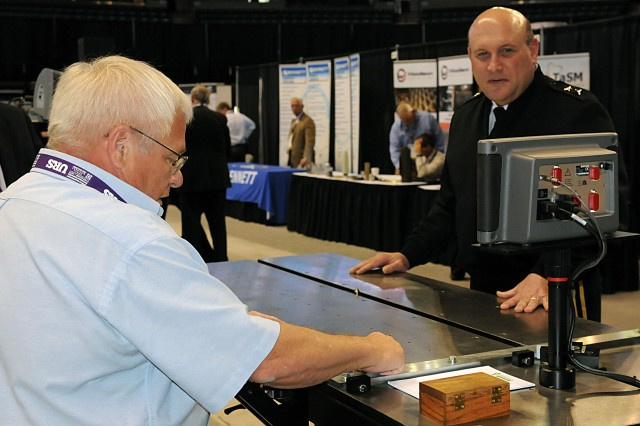 Maj. Gen. John Wharton watches a demonstration during the 2014 Midwest Small Business and Government Contracting Symposium at the iWireless Center in Moline, 7 May. (Photo by Sgt. 1st Class Shannon Wright, ASC Public Affairs)