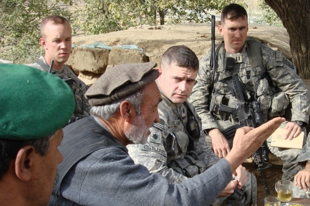 "Col. Bill Ostlund (center), then a lieutenant colonel who commanded the 2nd Battalion (Airborne), 503rd Infantry Regiment, 173rd Airborne Brigade Combat Team, and Maj. Matthew Myer (right), then a captain who commanded the battalion's ""Chosen"" company, meet with an Afghan village elder, Nov. 3, 2007, in Chapa Dara district, Kunar Province, Afghanistan. Former Army Sgt. Kyle White served in Myer's company when he took actions earning him a nomination for the Medal of Honor."