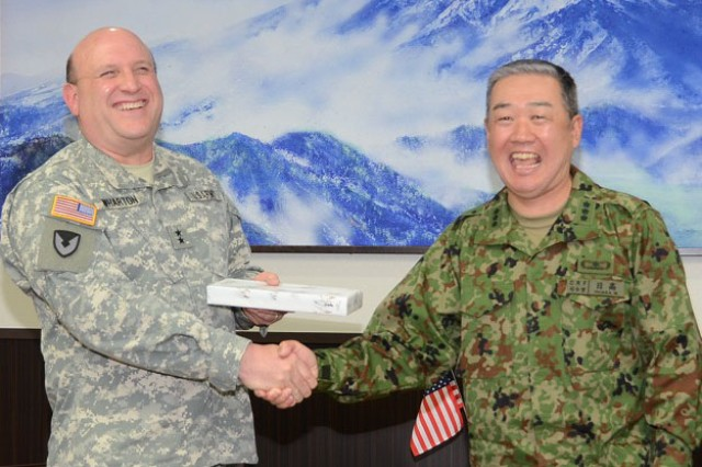 Maj. Gen. John Wharton, commanding general of Army Sustainment Command and Rock Island Arsenal, Ill., shares a light moment with Lt. Gen. Masahiro Hidaka, CG of Central Readiness Forces, Japan Ground Self-Defense Forces, at the JSDF Headquarters, located on Camp Zama, Japan, April 16.