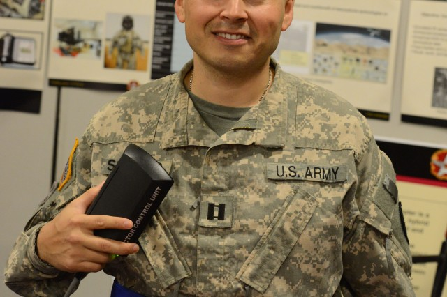 Capt. Ralph Salazar, research test pilot with U.S. Army Aeromedical Research Laboratory at Fort Rucker, Ala., shows the new Tactile Situation Awareness System. The device is embedded with sensors that vibrate in different areas of the body if the pilot is drifting or unintentionally changing altitude. He said this system could save lives in degraded environments such as dust storms and other poor visibility environments. The tactile feedback is important as pilots may already have sensory overload in auditory or visual channels.