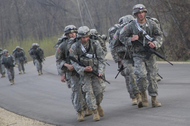 Army Reserve Combat engineers of the 382nd Engineer Company, 365th Engineer Battalion, 411th Engineer Brigade, 412th Theater Engineer Command, out of Harrisburg, Pa., participate in a 10.85-mile ruck march during the inaugural 2014 Sapper Stakes competition at Fort McCoy, Wis. The 382nd led the event with a finishing time of 2 hours, 37 minutes, securing them the win for the overall competition.