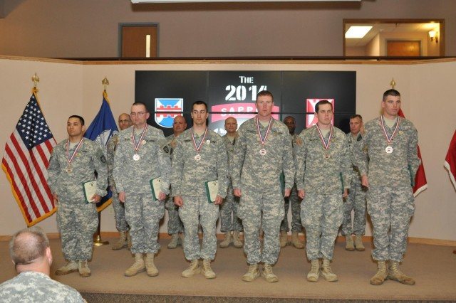 Second place winners Staff Sgt. Andres Rivera, Staff Sgt. Daniel Clark, Sgt. Andrew Sireno, Spc. Nathan Schuelke, Spc. Caleb Williams and Spc. Thomas Erickson of the 416th Theater Engineer Command's 469th Engineer Company, receive the Army Achievement Medal and recognition for their superior effort in the 2014 Combined 412th and 416th Sapper Stakes competition.