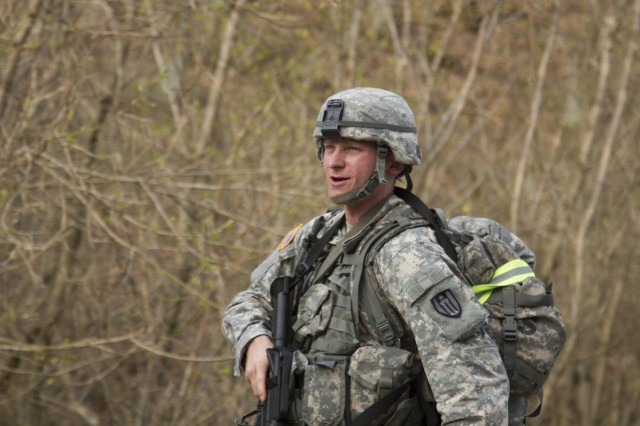 Spc. Mitchell Fromm of Stevens Point, Wis., with the 428th Engineer Company, 397th Engineer Battalion, 372nd Engineer Brigade, 416th Theater Engineer Command, participates in the 10.85-mile ruck march event, during the inaugural 2014 Sapper Stakes competition at Fort McCoy, Wis.