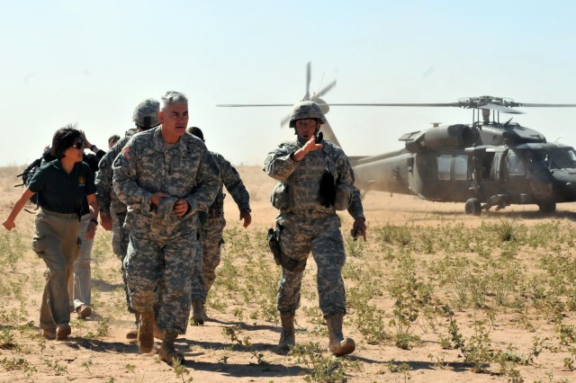 Col. Thomas Dorame, commander of 2nd Brigade Combat Team, 1st Armored Division, escorts Gen. John F. Campbell, vice chief of staff of the Army and Heidi Shyu, assistant secretary of the Army for Acquisition, Logistics and Technology, to the brigade's tactical operations center during the Network Integration Evaluation 14.2.