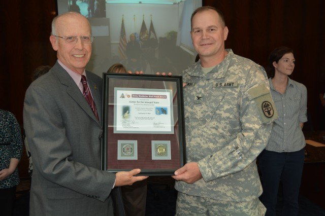 Gregg Stevens, the Army Medical Department Civilian Corps chief, presented the award on behalf of Army Lt. Gen. Patricia Horoho to Army Col. Donald Gajewski, CFI director May 7. The CFI staff was recognized for its exceptional teamwork working together with patients to maximize the effectiveness of rehabilitation to get back to military or civilian life.