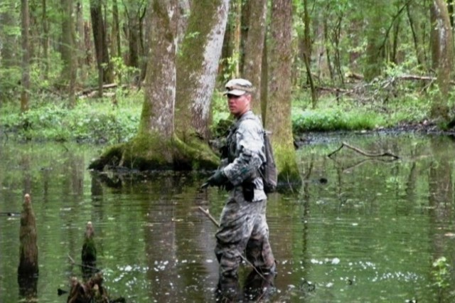 Sgt. David Fleming, a scout platoon team leader from Headquarters and Headquarters Company, 3rd Battalion, 15th Infantry Regiment, 4th Infantry Brigade Combat Team, 3rd Infantry Division, stands in a swamp during the land navigation portion of the 3-15 Inf., pre-ranger selection course, April 29, 2014, on Fort Stewart, Ga. (U.S. Army Photo by 2nd Lt. Jared Gray, 3-15 Inf., 4th IBCT, 3rd ID, UPAR)