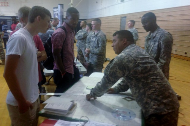 Soldiers with 1st Battalion, 76th Field Artillery Regiment, 4th Infantry Brigade Combat Team, 3rd Infantry Division explain to students how to map coordinates for artillery fire by hand at Statesboro High School's science, technology, engineering, and mathematics day in Statesboro, Ga., May 9, 2014. (Photo by Sgt. Bob Yarbrough, 4 IBCT, 3 ID, Public Affairs)