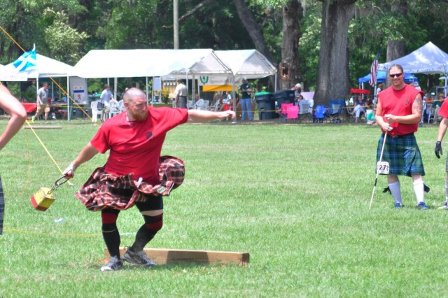 A competitor in the Heavy Athletics Competition throws a 22-pound weight during the Hammer Throw Event. The Hammer Throw is one of five events in the Heavy Athletics Competition during the Savannah Scottish Games, May 10, 2014.