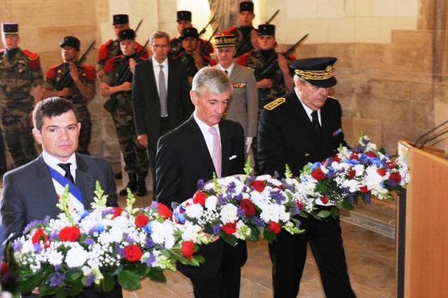 Secretary of the Army John M. McHugh (center), Chalons-en-Champagne Mayor Benoist Apparu (left) and Chalons-en-Champagne Prefect Pierre Dartout place wreaths at the Chalons-en-Champagne (France) town hall memorial, May 14, 2014. The hall is the site of the final selection of the Unknown Soldier on Oct. 24, 1921.