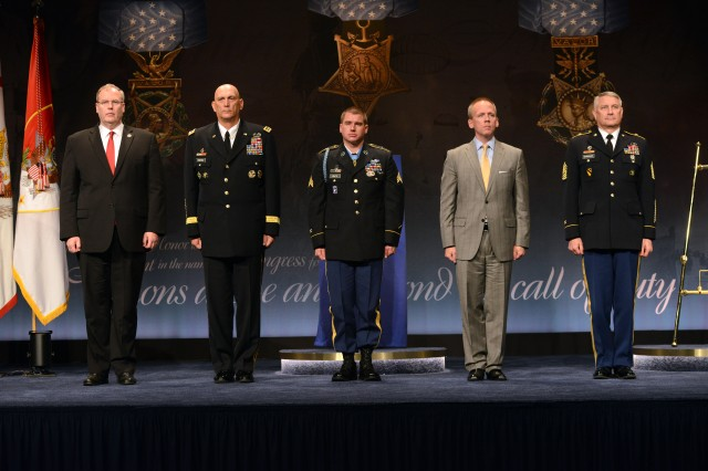Former Army Sgt. Kyle J. White is inducted into the Pentagon Hall of Heroes, May 14, 2014, one day after receiving the Medal of Honor for his actions in Afghanistan during the Battle of Aranas, in 2007. Pictured from left to right are: Deputy Secretary of Defense Robert O. Work, Chief of Staff of the Army Gen. Ray Odierno, White, Under Secretary of the Army Brad R. Carson, and Sgt. Maj. of the Army Raymond F. Chandler III.
