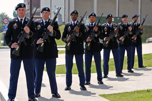 Soldiers from 304th Expeditionary Signal Battalion, 1st Signal Brigade stand ready to fire a salute at the memorial ceremony  in honor of Spc. Carl A. Lissone, Information Technology Specialist, Bravo Company, 304th ESB, 1st Signal Brigade, May 13 at USAG Humphreys, South Korea.
