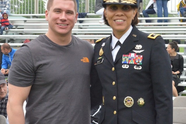 Medal of Honor recipient, former Army sergeant Kyle J. White, stands with Major General (Dr.) Nadja Y. West, Joint Staff Surgeon and host of the May 14, 2014 U.S. Army Military District of Washington's Twilight Tattoo prior to the performance.