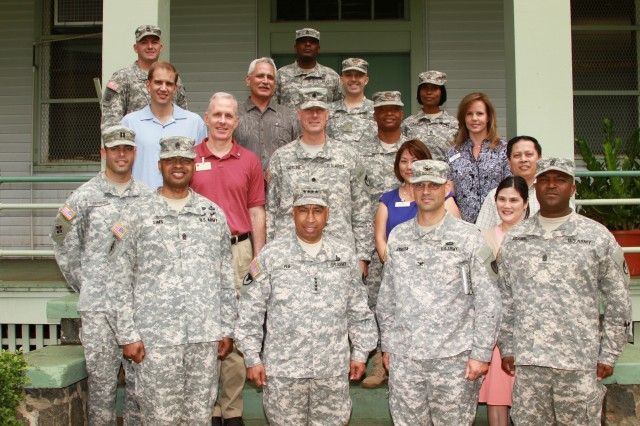 Members of the 413th Contracting Support Brigade with Gen. Dennis L. Via, Army Materiel Command commanding general (center).