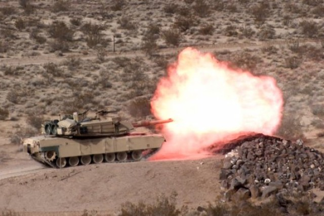 An M1A1 tank from 11th Armored Cavalry Regiment fires at Fort Irwin, Calif. The Advanced Multi-Purpose 120mm tank round now under development, could replace four different types of rounds currently used.
