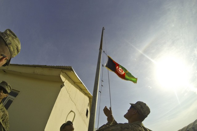 FORWARD OPERATING BASE AZZIZULAH,  Afghanistan -- Troopers with 3rd Squadron, combined task Force Dragoon, raise the Afghanistan flag during a transfer ceremony Nov. 15, 2013, at Forward Operating Base Azizulah, Afghanistan. Troopers recently relinquished authority of the base to the Afghan National Army and Afghan National Civil Order Police in support of Operation Enduring Freedom.