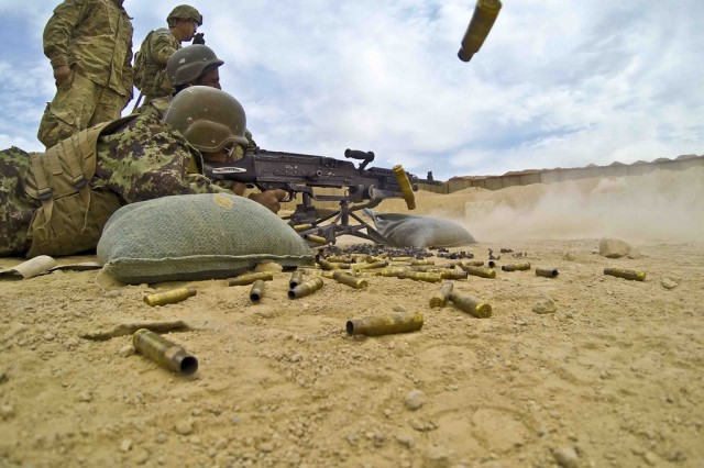 FORWARD OPERATING BASE PASAB, Afghanistan -- An Afghan National Army soldier with 3rd Brigade, 205th Corps, fires an M240B Machine Gun during a range Oct. 29, 2013, at Forward Operating Base Pasab, Afghanistan. U.S. Army Troopers of Security Force Assistance Team 3205 with 3rd Squadron, Combined Task Force Dragoon, taught the ANA soldiers the fundamentals of range operations and live-fire exercise in support of Operation Enduring Freedom.