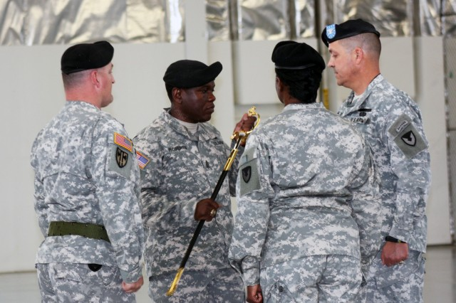 At the RIA-JMTC Relinquishment of Responsibility ceremony, Sgt. Maj. Ceaser Roberts, Jr. outgoing RIA-JMTC Sergeant Major, passes the NCO sword to Col. David J. Luders, commander RIA-JMTC.