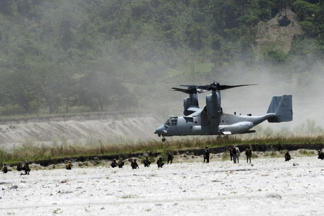 Filipino infantrymen from Company B, 20th Infantry Battalion, 8th Infantry Division, debark an MV-22 Osprey and secure their second objective during a multinational, joint force live-fire exercise rehearsal, May 13, as part of Balikatan 2014. Balikatan is an annual bilateral training exercise between the Philippines and U.S. designed to foster cooperation and interoperability between the two nations' armed forces through training as well as humanitarian aid and disaster relief projects. (U.S. Army photo by Staff Sgt. Chris McCullough)