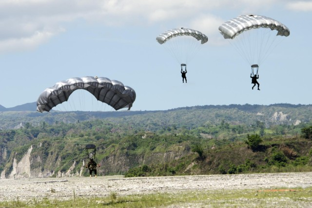 Filipino Special Operations Forces occupy a landing zone during a High Altitude Low Opening jump that was conducted as part of a multinational, joint force live-fire exercise, May 15, as part of Balikatan 2014. Balikatan is an annual bilateral training exercise between the Philippines and U.S. designed to foster cooperation and interoperability between the two nations' armed forces through training as well as humanitarian aid and disaster relief projects. (U.S. Army photo by Staff Sgt. Chris McCullough)