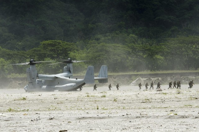Filipino infantrymen from Company B, 20th Infantry Battalion, 8th Infantry Division, debark an MV-22 Osprey and secure their second objective during a multinational, joint force live-fire exercise, May 15, as part of Balikatan 2014. Balikatan is an annual bilateral training exercise between the Philippines and U.S. designed to foster cooperation and interoperability between the two nations' armed forces through training as well as humanitarian aid and disaster relief projects. (U.S. Army photo by Staff Sgt. Chris McCullough)