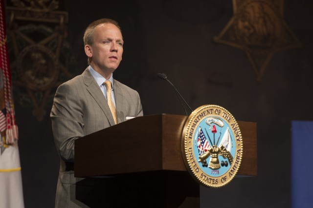 Under Secretary of the Army Brad R. Carson speaks at the Hall of Heroes induction ceremony for former Sgt. Kyle J. White, at the Pentagon, May 14, 2014. White was inducted into the Hall of Heroes, a ceremonial room at the Department of Defense headquarters, one day after he received the Medal of Honor for actions in Afghanistan during the Battle of Aranas, in 2007.  (U.S. Army photo by Staff Sgt. Bernardo Fuller)
