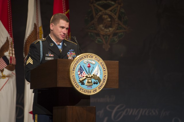 Former Army Sgt. Kyle J. White talks about the Battle of Aranas and the six service members killed during the Nov. 9, 2007, battle in Afghanistan. He spoke at the Pentagon, May 14, 2014, during his induction into the Hall of Heroes, one day after receiving the Medal of Honor, at the White House.  (U.S. Army photo by Staff Sgt. Bernardo Fuller)