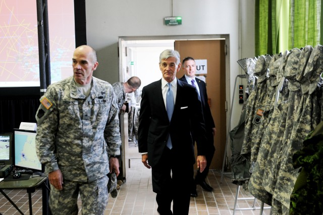 Secretary of the Army John M. McHugh and Brig. Gen. John Gronski, 28th Infantry Division commander, tour the division headquarters' tactical operations center at the French military camp Mourmelon, May 15, 2014. More than 300 28th Infantry Division Soldiers are participating in the three-week Rochambeau 2014 NATO exercise.