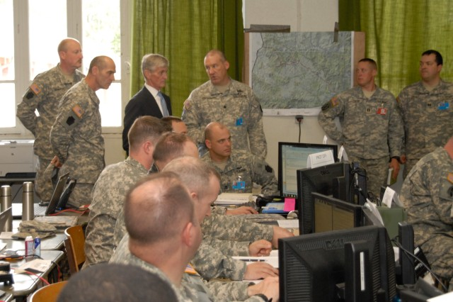 Brig. Gen. John Gronski (second from left), 28th Infantry Division commander, and staff officers brief Secretary of the Army John M. McHugh on the Rochambeau 2014 exercise at the French military camp Mourmelon, May 15, 2014.