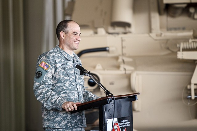 Brig.  Gen. David G. Bassett, the Army's program executive officer for Ground Combat Systems, addresses the team on how the M109A7 self-propelled howitzer and its companion M992A3 carrier ammunition tracked vehicle are examples of acquisition excellence.