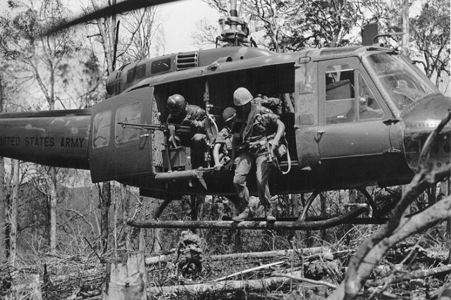 Screaming Eagle Soldier exit a Huey during an Air Assault mission in Vietnam.