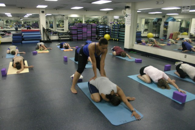 Lt. Col. Michele Spencer, 48th Combat Support Hospital, (center, blue top) leads a free yoga class at Gaffney Fitness Center.