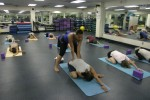 Army MWR patrons enjoy yoga at fitness center