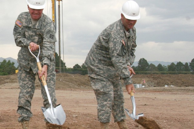 Maj. Gen. David G. Perkins, commanding general, 4th Infantry Division and Fort Carson, left, and Col. Robert F. McLaughlin, garrison commander, participate in the groundbreaking ceremony Monday for a new Fort Carson fitness center. The 92,496 square foot facility that will feature a gymanasium, two swimming pools, a climbing wall and indoor track is expected to open in January 2012.