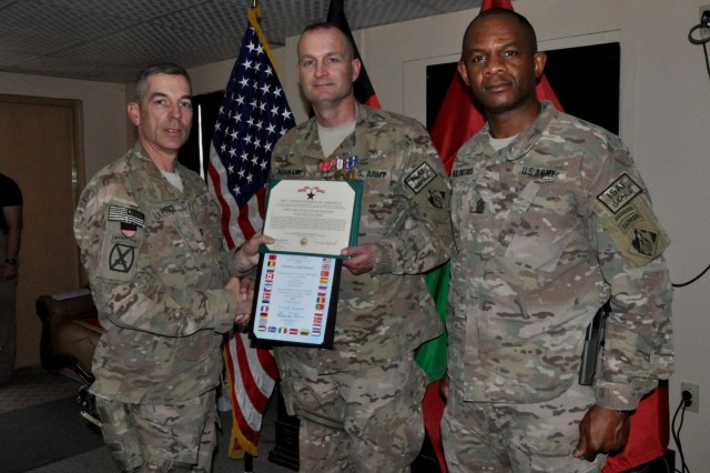 The Bronze Star medal was presented to Lt. Col. Kendall A. Bergmann on behalf of Transatlantic Division Commander Maj. Gen. Michael Eyre, by the Transatlantic Afghanistan District Commander Col. Michael Price during a May 16, 2014 ceremony at Bagram Air Field, Afghanistan.