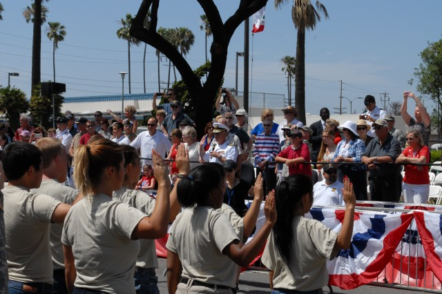 Rear Adm. Patrick Lorge administers the oath of enlistment to over 800 new recruits during the Torrance Armed Forces Day Parade