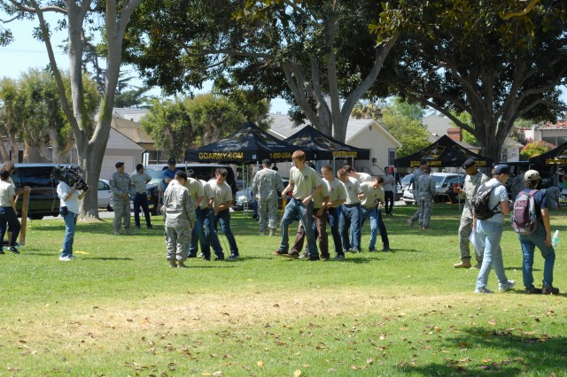 New recruits work on team building during the pre-parade barbecue before the Torrance Armed Forces Day Parade.