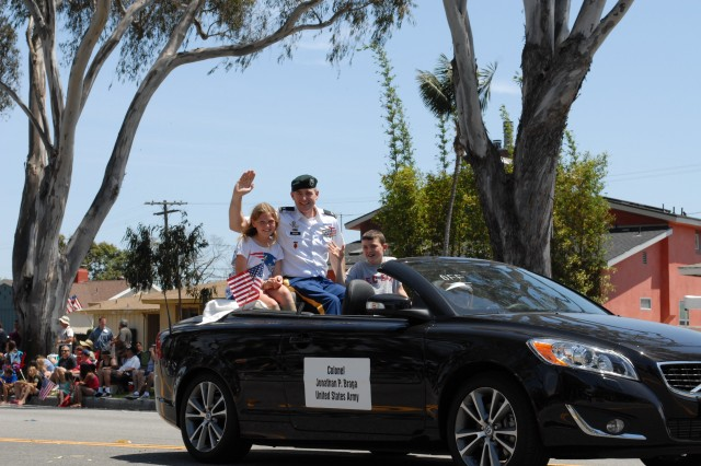 Col Johnathan Braga, Garrison Commander, the National Training Center and Fort Irwin waves to the crowds at the Torrance Armed Forces Days Parade