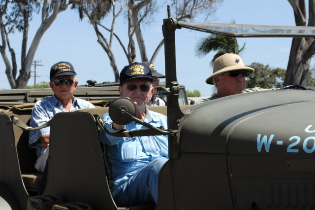 Veterans of WWII ride in a vintage military vehicle in the Torrance Armed Forces Days
