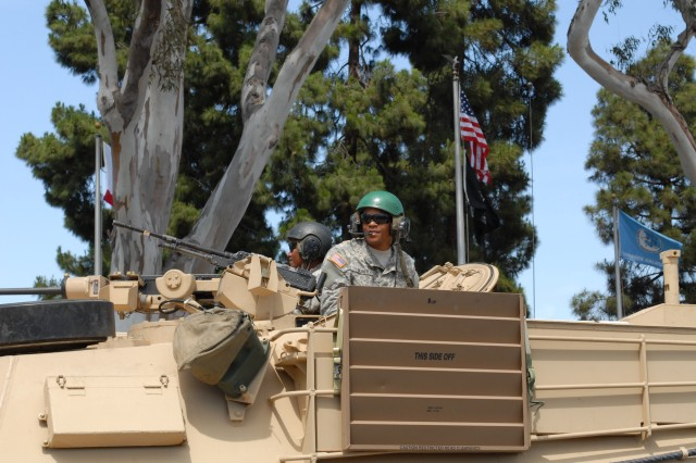 Soldiers from the 11th ACR drive a M1 Abrams tank down Torrance Blvd during the Torrance Armed Forces Day Parade