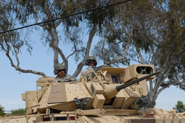 Soldiers from the 11th ACR drive a Bradley Fighting Vehicle in the 55th Torrance Armed Forces Day Parade